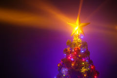 Christmas tree with shining star and frozen mist Stock Image