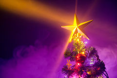 Christmas tree with shining star and frozen mist Royalty Free Stock Images