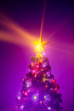 Christmas tree with shining star and frozen mist Stock Images