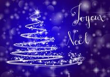 Christmas tree on shiny blue background with the writing. Abstract Christmas tree on shiny blue background with the writing `Merry Chistmas` in french `Joyeux Royalty Free Stock Photos