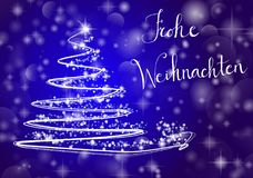 Christmas tree on shiny blue background with the writing. Abstract Christmas tree on shiny blue background with the writing `Merry Chistmas` in German `Frohe Royalty Free Stock Photography