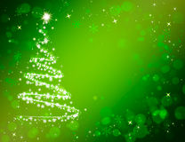Christmas tree on shiny festive green background. Bokeh Royalty Free Stock Photo