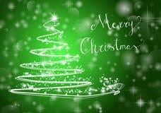 Christmas tree on shiny green background with the writing `Merry Christmas`. Abstract Christmas tree on shiny green background with the writing `Merry Christmas Royalty Free Stock Photos