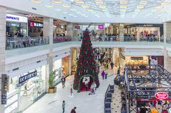Christmas tree in a shopping mall. Interior view of Afi Cotroceni shopping mall, with a decorated Christmas tree, Bucharest, Romania Stock Images