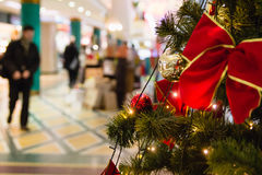 Christmas tree in shopping mall. Christmas tree with lights in shopping mall during holiday Stock Photography