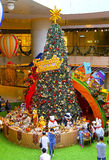 Christmas tree at shopping mall. Visitors enjoying the display of huge christmas tree and related decorations at elements shopping mall in hong kong Stock Images