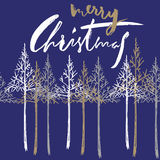 Christmas tree silhouette, design for greeting card. Vector hand drawn lettering for design. Gold Christmas lettering Stock Photo