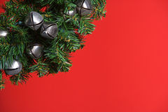 Christmas tree with silver bells. Isolated on red Royalty Free Stock Images