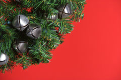 Christmas tree with silver bells. Isolated on red Stock Photos
