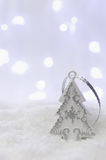 Christmas Tree. Silver Decorations on Snow. Selective focus. Copy Space for Text. Royalty Free Stock Image