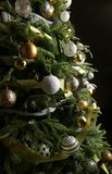Christmas tree. Silver and golden balls. Close up royalty free stock images
