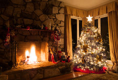 Christmas tree and rustic fireplace in a cozy home Stock Images