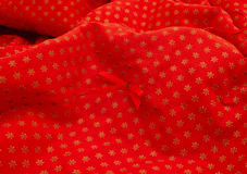 Christmas Tree Skirt2. Close up of a red Christmas tree skirt royalty free stock images