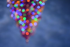Christmas tree with sky background. Vintage styled holiday abstract bokeh. Shine, decorate, shiny, design, blue, glowing, bright, holiday, golden, effect royalty free stock photo