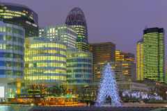 Christmas tree among the skyscrapers of La Defense, Paris, France. Royalty Free Stock Images
