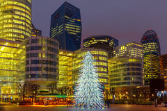 Christmas tree among the skyscrapers in Paris, France. Stock Photo