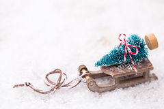 Christmas tree on the sled. Christmas and new year gold theme background Stock Photos
