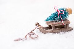 Christmas tree on the sled. Christmas and new year gold theme background Royalty Free Stock Images