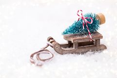 Christmas tree on the sled. Christmas and new year gold theme background Royalty Free Stock Photo