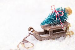 Christmas tree on the sled. Christmas and new year gold theme background Royalty Free Stock Photos