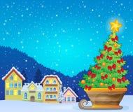 Christmas tree on sledge near village Royalty Free Stock Photo