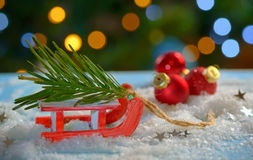 Christmas tree and sleigh decoration Royalty Free Stock Image