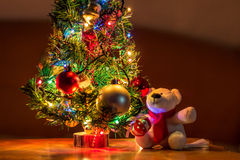 Decorated Christmas Tree. Small decorated Christmas Tree and teddy bear Stock Image