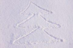 Christmas tree on a snow. Christmas tree drawn on a snow Royalty Free Stock Photos