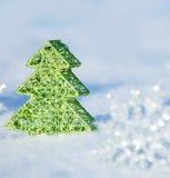 Christmas tree on snow Royalty Free Stock Photo