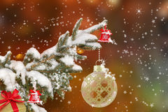 Christmas tree with snow, baubles and bells Royalty Free Stock Image