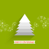 Christmas tree with snow flakes. White layered Christmas tree with snow flakes and green background Royalty Free Stock Image