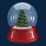 Christmas tree in a snow globe Stock Photo
