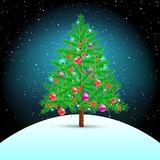 Christmas tree on snow hill. Christmas tree on night winter hill background. Spruce fir with toys ribbons cones and lights in branches. Green needles plant with Royalty Free Stock Image