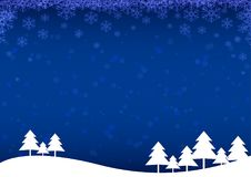 Christmas tree with snow and snowflakes on blue background Stock Photography