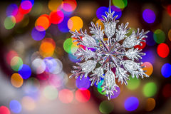 Christmas tree snowflake decoration on lights background Royalty Free Stock Photos