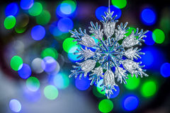 Christmas tree snowflake decoration on lights background Royalty Free Stock Photo