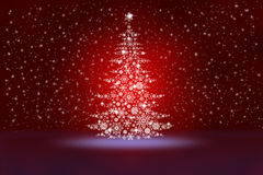 Christmas tree from snowflakes on an abstract red background Royalty Free Stock Photos