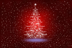 Christmas tree from snowflakes on an abstract red background Royalty Free Stock Images