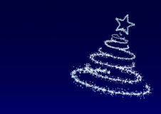 Christmas tree from snowflakes at  blue background. Christmas tree from snowflakes. The effect of a blizzard which draws a fur-tree Stock Photography