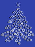 Christmas tree with snowflakes over blue Stock Photo