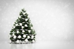 Christmas tree. Snowing and glitter background Stock Images