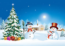 Christmas tree with snowman and christmas balls. On a background of a winter landscape Stock Photography