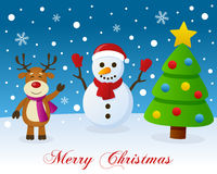 Christmas Tree, Snowman & Cute Reindeer. A merry Christmas greeting card with a Christmas tree, a cute reindeer smiling and a happy snowman in a snowy scene Royalty Free Stock Images