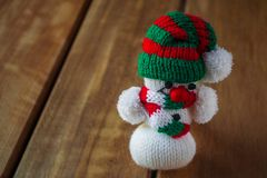 Christmas tree snowman decoration figure. On wood texture Royalty Free Stock Photo