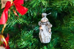 Christmas tree snowman decoration. Christmas or New Year background with green christmas tree branch, snowman decoration Royalty Free Stock Photo