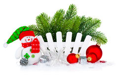 Christmas tree with snowman and red balls Royalty Free Stock Photo