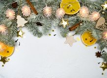 Christmas tree snowy branch border with new year decor and lights on white snow background with copy space