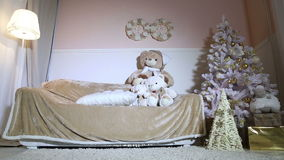 Christmas tree, sofa, soft toys, floor lamp in the room stock video footage