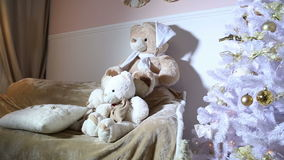 Christmas tree, sofa, soft toys in the room stock video footage