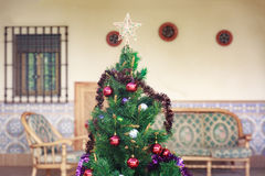 Christmas tree with some ornaments and a small star. On top royalty free stock image